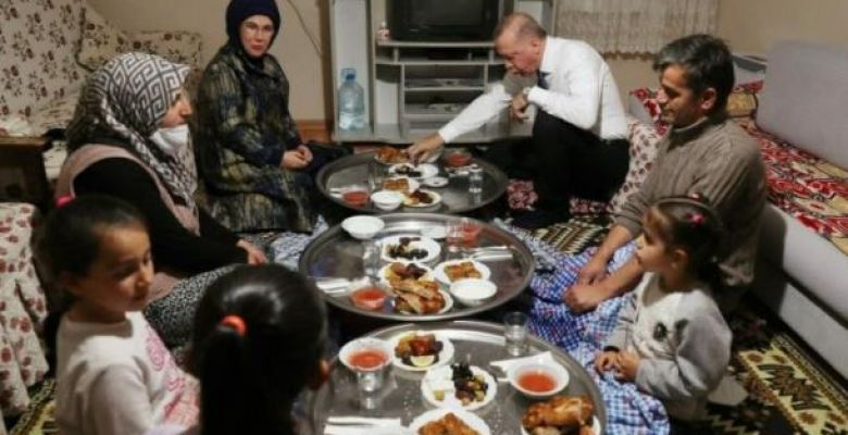 Turkey's President Erdogan breaking fast at home of a citizen